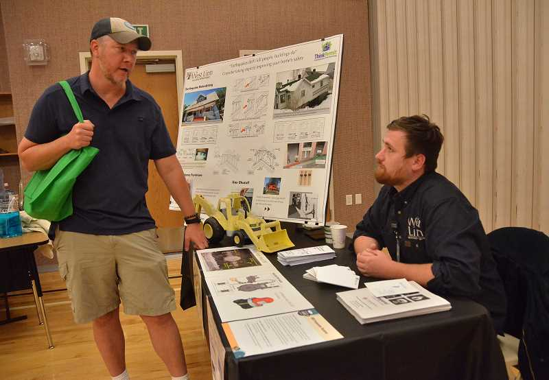 TIDINGS PHOTO: VERN UYETAKE - Josh Roberts, left, chats with Adam Bernett with the City of West Linn about shutting off a gas line.