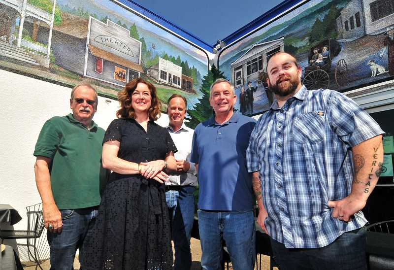 REVIEW PHOTO: VERN UYETAKE - Oswego Heritage Council Board President Tom OConnor (from left), OHC Executive Director Nancy Niland, Lake Oswego Ice Creamery and Restaurant Owner Stan Prentice, OHC Archival Manager Mark Browne and Ice Creamery General Manager Matt Whipple pose in front of a new mural depicting the early days of Oswego's A Avenue.