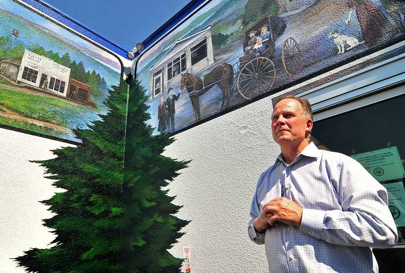 REVIEW PHOTO: VERN UYETAKE - Lake Oswego Ice Creamery and Restaurant Owner Stan Prentice explains a few of the hidden facets of the mural to members of the Oswego Heritage Council.