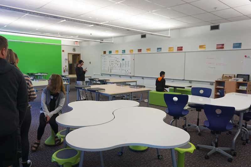 REVIEW PHOTO: CLAIRE HOLLEY - Parents and students check out the model classroom at Lakeridge Junior High, which  looks much like the classrooms will when the school is rebuilt.