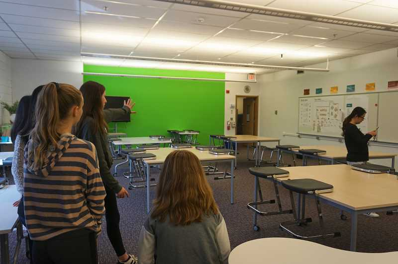 REVIEW PHOTO: CLAIRE HOLLEY - Lakeridge Junior High eighth-graders say even though they won't get to use the rebuilt school, it's great to see the type of classrooms younger students will get to enjoy.