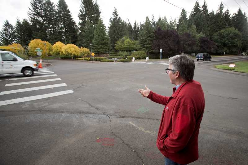 TIMES PHOTO: JAIME VALDEZ - Jeff Fuchs, public works director of the City of Tualatin, shows where a pedestrian activated crosswalk will be constructed at the intersection of SW Boones Ferry Road and Siletz.