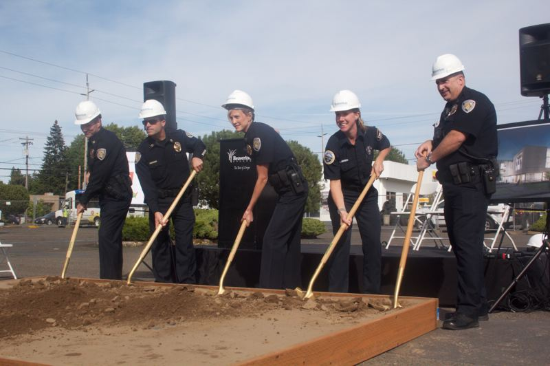 PAMPLIN MEDIA GROUP: STEPHANIE BASALYGA - Members of the Portland police department prepare to dig in during a groundbreaking event held Sept. 17. The police department will share the new building with the citys Office of Emergency Mangement.