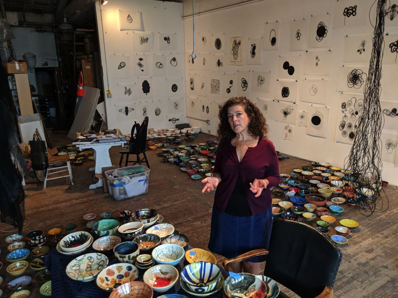 TRIBUNE PHOTO: JOSEPH GALLIVAN - Sculptor Dana Lynn Louis wanted to make a difference, and her Gather: Make: Shelter project hopes to raise money for homeless people. She helped guide makers of ceramic bowls, which will be sold Sunday, Sept. 23 at Pioneer Courthouse Square, noon to 4 p.m.