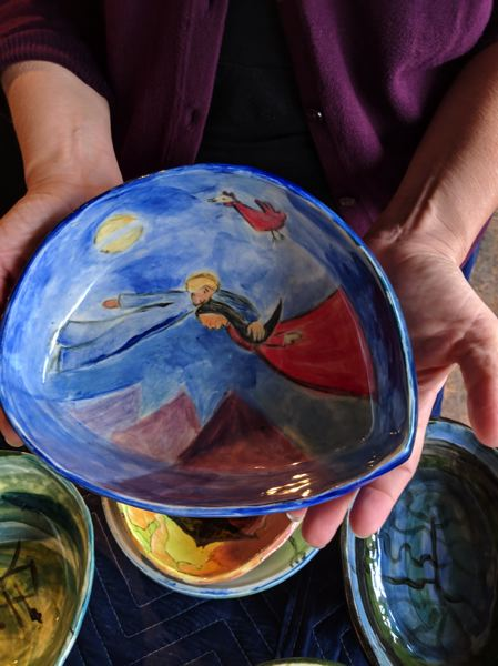 TRIBUNE PHOTO: JOSEPH GALLIVAN - Bowls included in Dana Lynn Louis project were painted by people who have experienced homelessness.This was influenced by Marc Chagall's work.