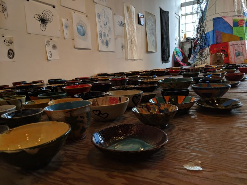 TRIBUNE PHOTO: JOSEPH GALLIVAN - Sculptor Dana Lynn Louis wanted to make a difference, and her Gather: Make: Shelter project hopes to raise money for homeless. She helped guide makers of ceramic bowls, which will be sold Sunday, Sept. 23 at Pioneer Courthouse Square.