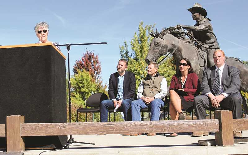 JASON CHANEY - Local leaders and Facebook representatives gather at the Prineville City Hall plaza to announce another Facebook data center expansion. Pictured left to right are Prineville Mayor Betty Roppe, KC Timmons, Facebook's director of site operations for its west region, Oregon Rep. Mike McLane, Crook County High School Principal Michelle Jonas, and Crook County Judge Seth Crawford.