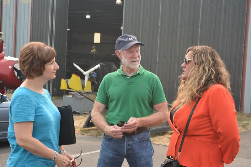 SPOTLIGHT FILE PHOTO - Congresswoman Suzanne Bonamici, left, speaks with Craig Allison and Paula Miranda, both with the Port of Columbia County, during a mid-August visit to Scappoose. Bonamici will be hosting a town hall meeting in Scappoose on Saturday, Sept. 22.