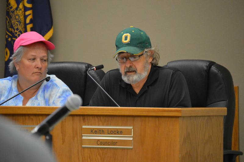 SPOTLIGHT PHOTO: NICOLE THILL-PACHECO - City council member Keith Locke, right, provides comments about an appeal presented to the council for a retail pot shop to be established in the Riverfront District at 100 St. Helens St. The council voted unanimoulsy to approve the conditional use permit a month after reaching a tie vote in August, when Locke was absent.
