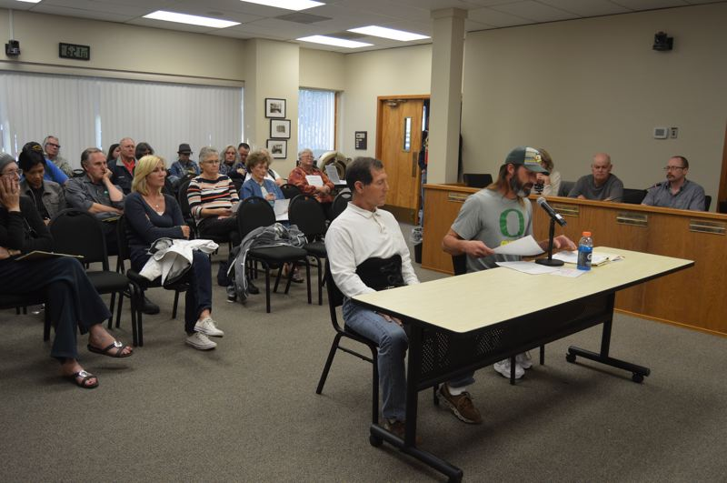 SPOTLIGHT PHOTO: NICOLE THILL-PACHECO - St. Helens Mayor Rick Scholl, right center, speaks to the St. Helens City Council on Wednesday, Sept. 19, during a public hearing where he requested a street vacation for properties he owns along 8th, 9th, and Wyeth streets. The vacation would allow him to put in a 20-foot-wide roadway — a deviation from the citys standard 60-foot-wide roadway — which would provide access to the properties near the top of the bluff.