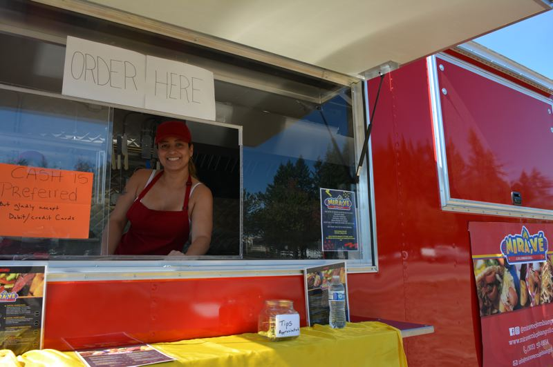 SPOTLIGHT PHOTO: COURTNEY VAUGHN - Veronika Ortega, co-owner of Mira Ve, a Colombian food truck temporarily operating in Scappoose, says her truck will likely move to St. Helens soon. Scappoose does not yet allow for food trucks to operate year-round.