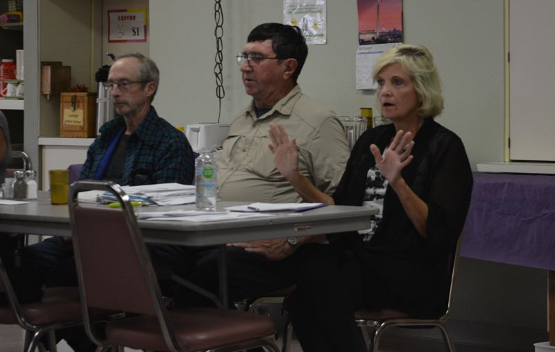 SPOTLIGHT PHOTO: COURTNEY VAUGHN - Julie Stephens (right) addresses a speaker during a board meeting at the Scappoose Senior Center. Pictured to her left, Board President Leeroy Schmidt and Robert Glossenger.