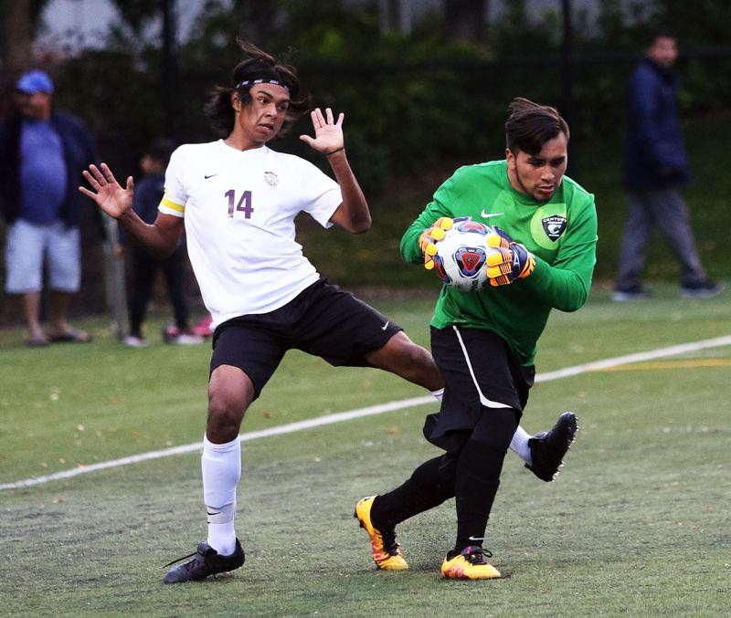 4931e9533f7 TIMES PHOTO  DAN BROOD - Century junior goalkeeper Edgar Chavez grabs the  ball before Tualatin