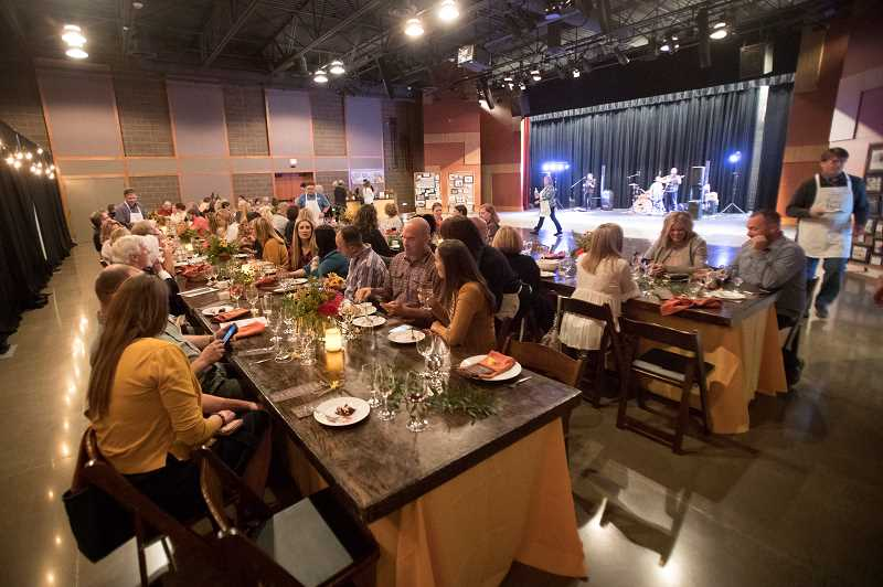 PHOTO: JAIME VALDEZ - Residents of Sherwood sit down for a formal dinner during Sherwood's 125th Birthday at the Sherwood Center for the Arts.