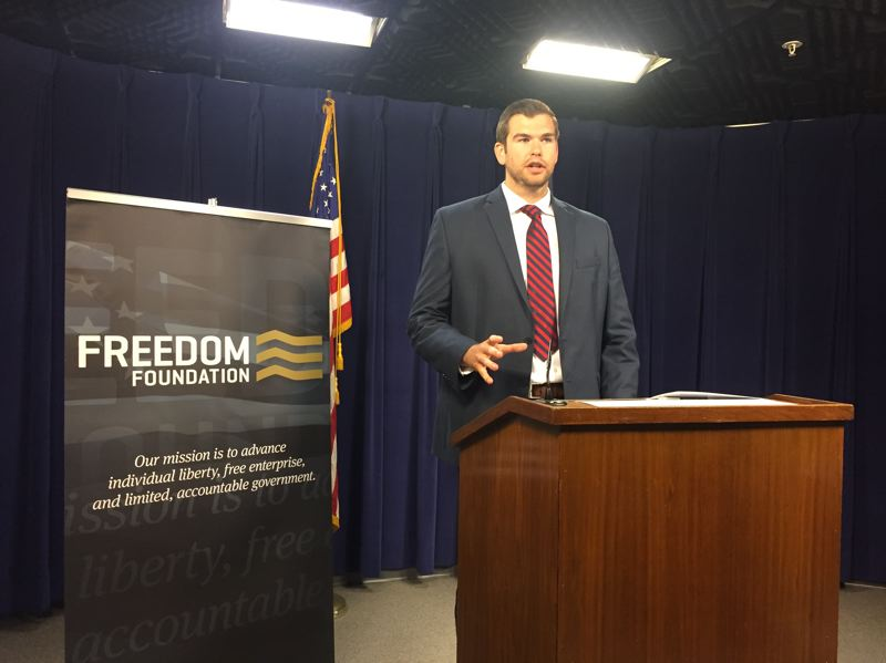 PARIS ACHEN/CAPITAL BUREAU - Aaron Withe of the Freedom Foundation speaks to reporters at the Oregon State Capitol in Salem July 2, 2018.