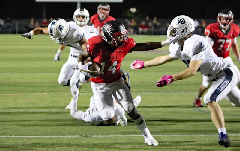 PAMPLIN MEDIA: JIM BESEDA - Clackamas' Jailen Hammer (14) wards off Lake Oswego's Miles Lewis as scores on a two-point conversion with 10:11 to play in the second quarter of Friday's non-conference home game.