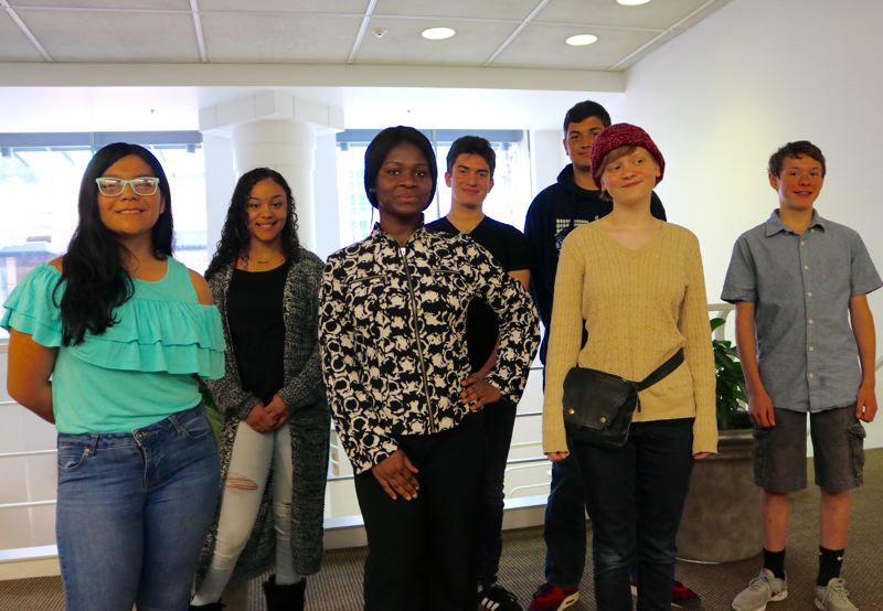 TRIBUNE PHOTO: ZANE SPARLING - Some of the participants in the Debate for Oregon's Future pose for a photo inside the KOIN Center tower on Saturday, Sept. 22 in Portland. From Left: Genesis Gomez, Ja Neciya Ross, Tosha Kitungano, Adi Solomon, Shimon Dasgupta, Rose Lawrence and Jeremy Clark