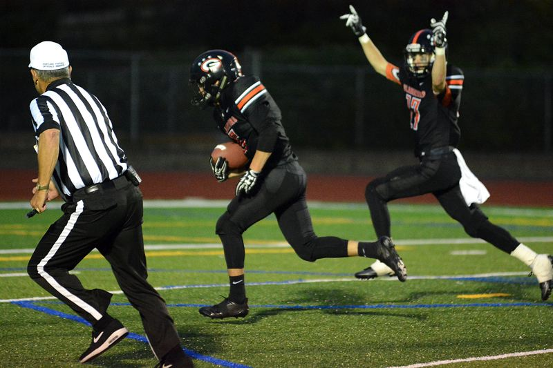 PAMPLIN MEDIA GROUP PHOTO: MILES VANCE - Gladstone's Austin Conner races 16 yards to score after picking up an Estacada fumble during his team's 42-22 upset of the top-ranked Rangers.