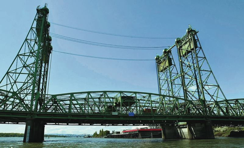 PORTLAND TRIBUNE FILE PHOTO - Frequent lifts for ships contribute to the congestion caused by the narrow, aging I-5 bridge.