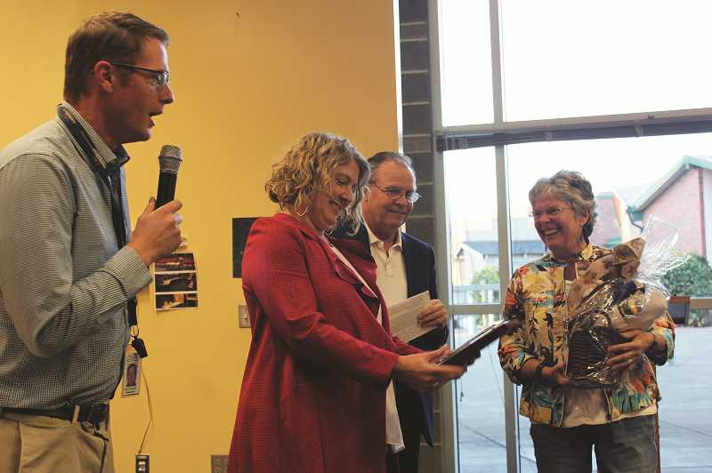 HERALD PHOTO: KRISTEN WOHLERS - Ninety-One School Secretary Cheryl Beyer receives the CARE Award at the Sept. 20 school board meeting. Principal Skyler Rodolph (left) says a few words. Also pictured are Superintendent Trip Goodall and Kiwanis's Marilyn Wood.