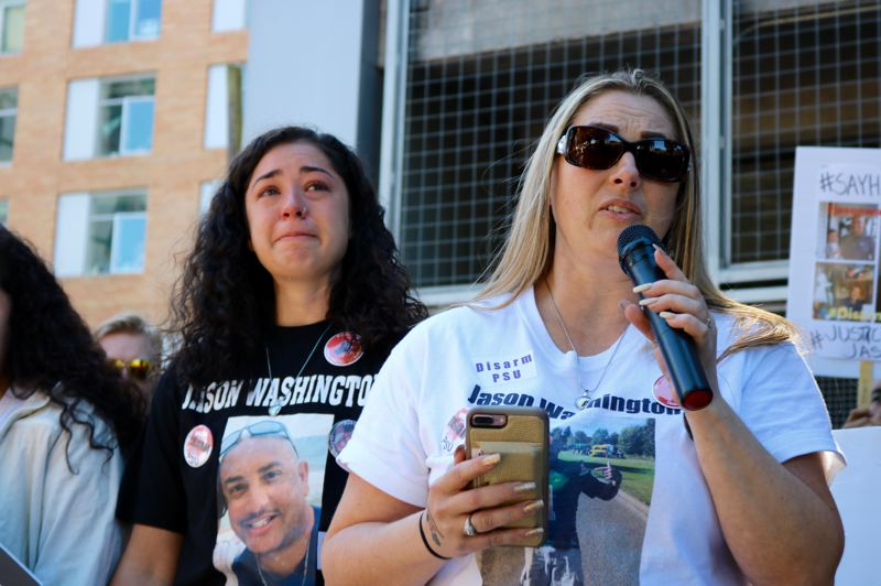 TRIBUNE PHOTO: ZANE SPARLING - Michelle Washington, the widow of Jason Washington, speaks on Monday, Sept. 24, at the spot where her husband was killed in June.