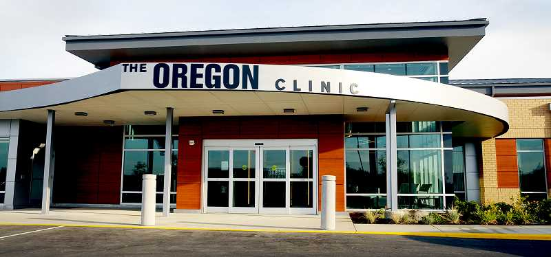 GARY ALLEN - The Oregon Clinic moved into its gleaming metal and wood structure on Sept. 24.
