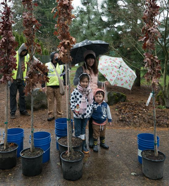 COURTESY PORTLAND PARKS & RECREATION  - A family waits in the rain at the 2017 city tree giveaway event.