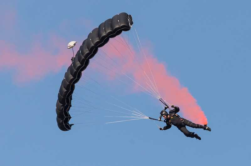 STAFF PHOTO: CHRISTOPHER OERTELL - A member of the US Special Operations Command Parachute team drops onto show center during the Oregon International Airshow at Hillsboro Airport last year.
