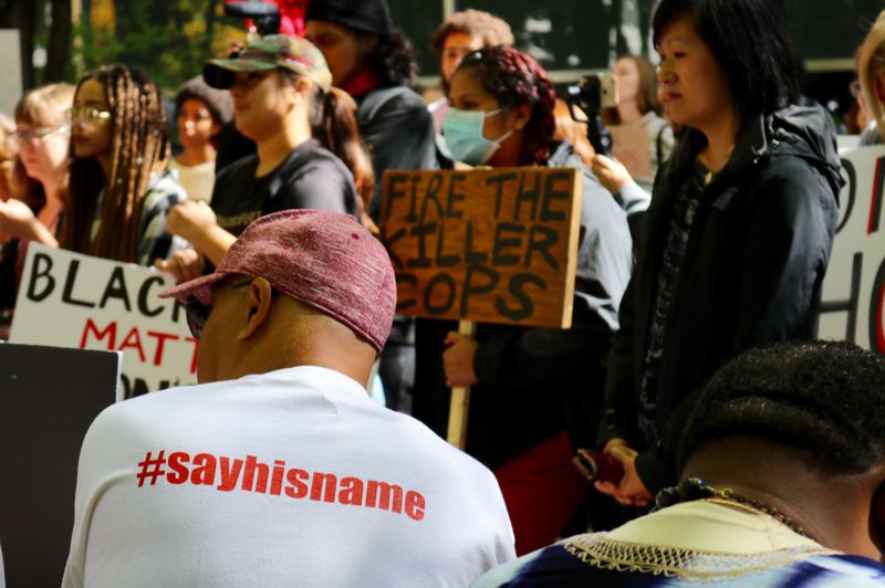TRIBUNE PHOTO: ZANE SPARLING - Andre Washington, Jason Washington's brother, wears a shirt with the hashtag 'say his name' during a protest at Portland State University on Monday, Sept. 24.