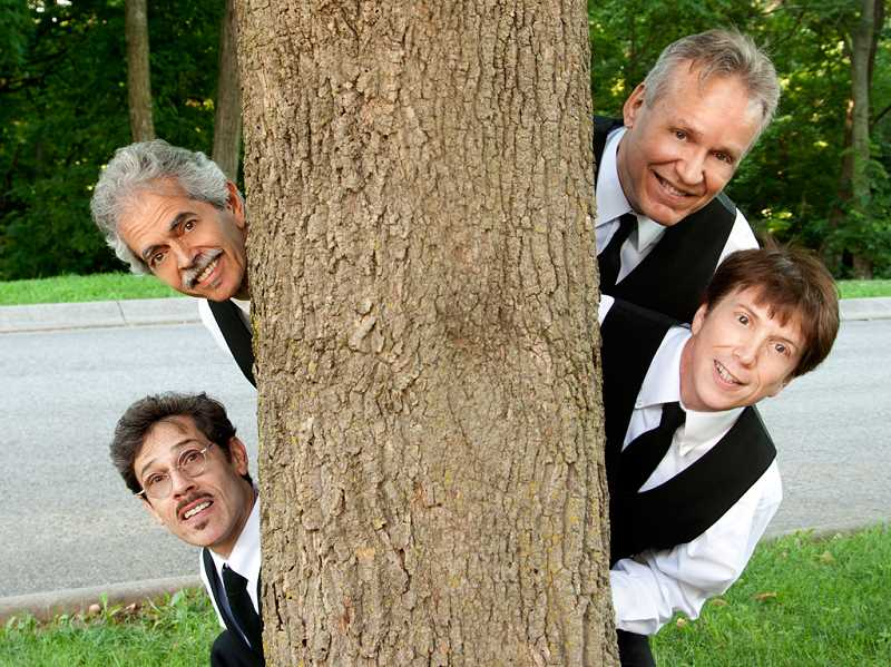 SUBMITTED PHOTO - Expect comedy, onstage antics and audience participation when The WannaBeatles perform Oct. 3 at the Rotary Sounds Concert in Lake Oswego.