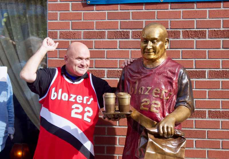 OUTLOOK PHOTO: CHRISTOPHER KEIZUR - Todd Kirnan was all smiles Saturday afternoon, Sept. 22, as he celebrated the unveiling of a bronze statue in his likeness in downtown Gresham.