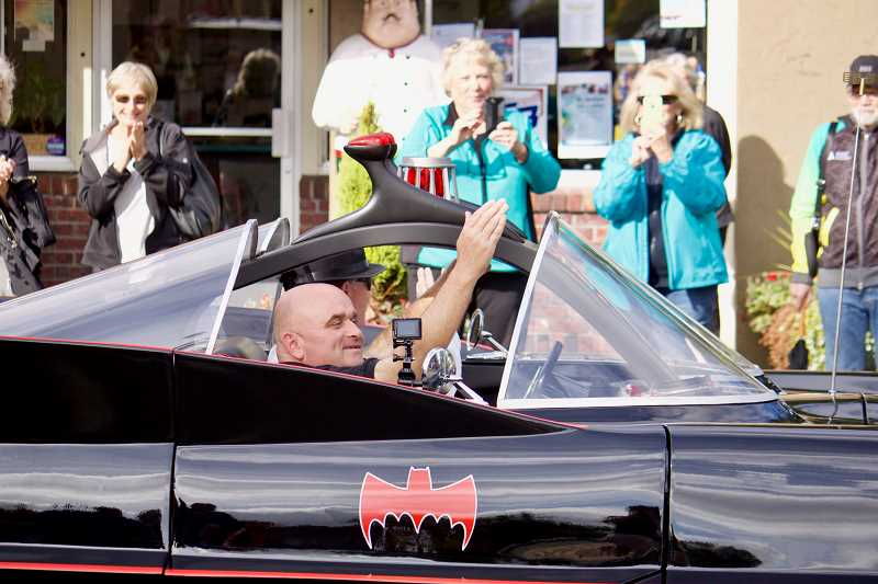 OUTLOOK PHOTO: CHRISTOPHER KEIZUR - Kirnan arrived in style to his community celebration, cruising down Main Avenue in a Batmobile car.