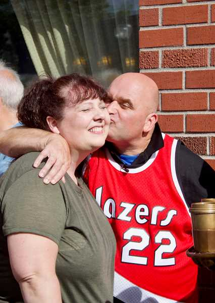 OUTLOOK PHOTO: CHRISTOPHER KEIZUR - Todd Kirnan, aka Mr. Gresham, shared a moment with his sister Suzette Rackley during the celebration Saturday, Sept. 22.