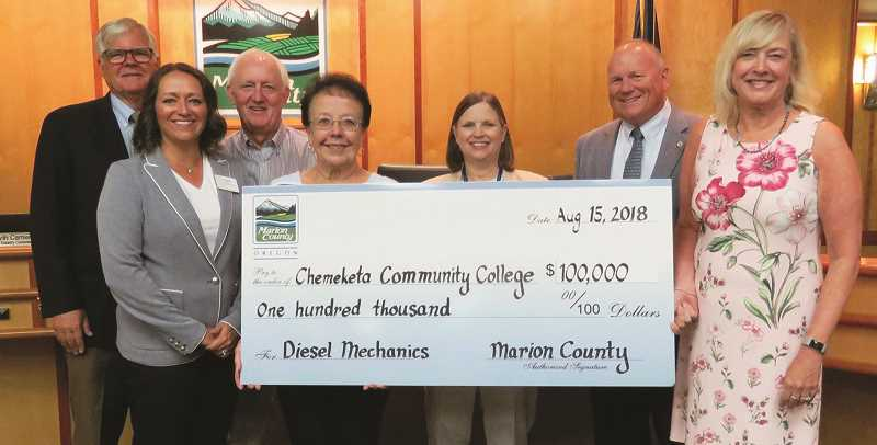 COURTESY PHOTO - Pictured from left: Marion County Commissioner Kevin Cameron, Chemeketa Executive Dean Holly Nelson, Chemeketa Board members Ken Hector and Neva Hutchinson, Marion County Commissioners Janet Carlson and Sam Brentano, Chemeketa President and CEO Julie Huckestein.