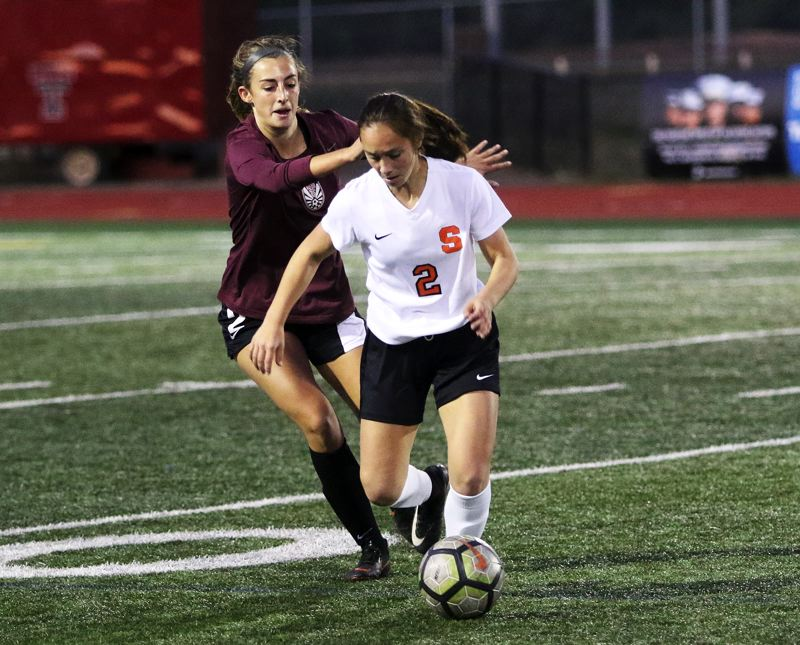 PAMPLIN MEDIA GROUP: DAN BROOD - Scappoose sophomore Anika Havlik keeps ahead of Tualatin junior Abby Borg during Mondays non-league match at Tualatin.