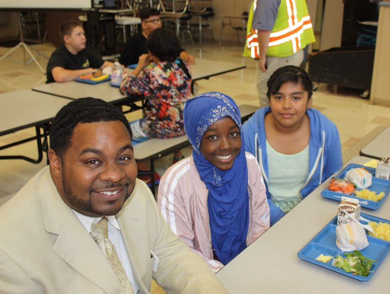 CONTRIBUTED PHOTO: CENTENNIAL SCHOOL DISTRICT - Paul Coakley, superintendent of Centennial School District, hangs out with some students on the first day of school.