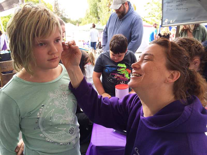 PIONEER PHOTO: CAROL ROSEN - Face painting was one of the popular activities at Celebrate Molalla on Saturday, Sept. 22.