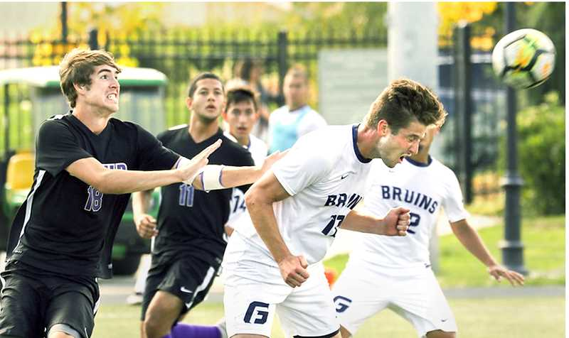 PHOTO COURTESY OF GFU - George Fox junior defender Rowan Blake heads the ball Sunday during the Bruins' 1-1 tie versus Linfield. GFU will travel to play Pacific Lutheran Saturday and Puget Sound Sunday.