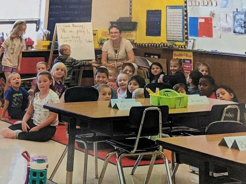 CONTRIBUTED PHOTO: ESTACADA SCHOOL DISTRICT - Students at River Mill Elementary School gather around their teacher during the first day of school. This year, River Mill saw an increase of 35 students.
