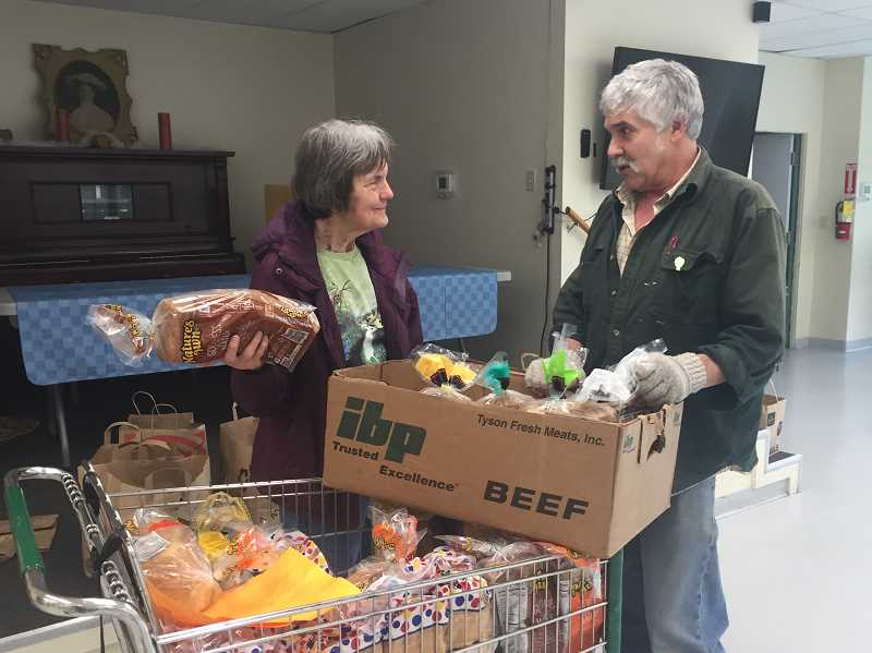 FILE PHOTO - Jan Melcher carries bags filled with food for Meals on Wheels recipients in Estacada. Melcher recently recieved the AARP Oregon Andrus Award for Community Service for her efforts.