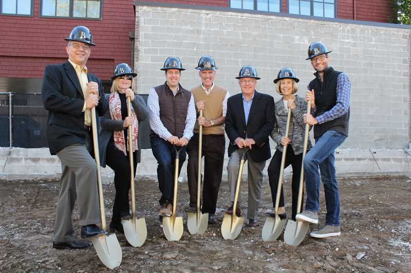 REVIEW PHOTO: SAM STITES - Lake Oswego City Councilors and Mayor Kent Studebaker pose for a photo with the Haladays during the groundbreaking celebration for Beacon Lake Oswego. From left: Councilor John LaMotte, Councilor Jackie Manz, Miles Haladay, Mayor Kent Studebaker, Jay Haladay, Renee Haladay and Councilor Joe Buck.