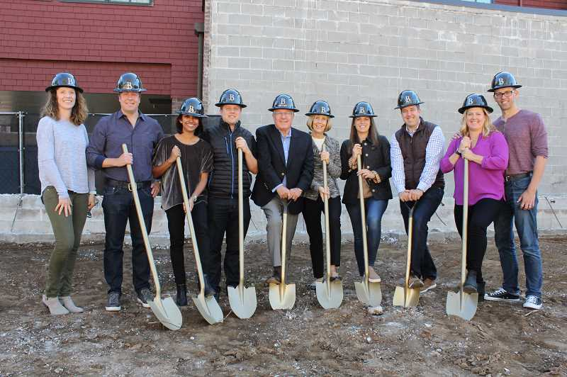 REVIEW PHOTO: SAM STITES - Members of 10 Branch LLC pose for a photo at the groundbreaking ceremony for Beacon Lake Oswego. 10 Branch LLC is comprised of members of Lake Oswego's Haladay family.