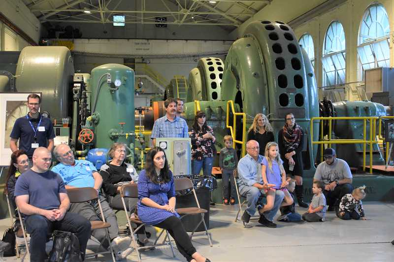 ESTACADA NEWS PHOTO: EMILY LINDSTRAND - Attendees at a recent gathering at the Faraday Powerhouse listen as Portland General Electric shares plans for the powerhouses future.