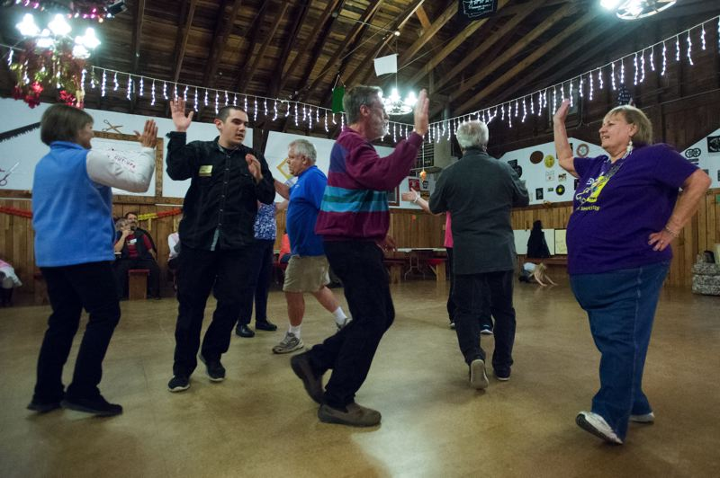 FILE PHOTO - Learn to dance in a square with members of the Country Cut-Ups Square Dance Club in Boring. Lessons are held Thursdays. See listing for details.