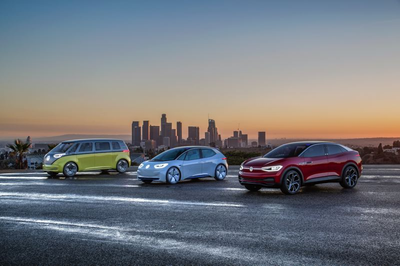 COURTESY VW - Examples of all-electric vehicles VW expects to produce in coming years, including the  I.D. Buzz, a retro-lookalike to the iconic VW Microbus of the 1950s-1970s, on the left, and the I.D. Crozz compact crossover, on the right.