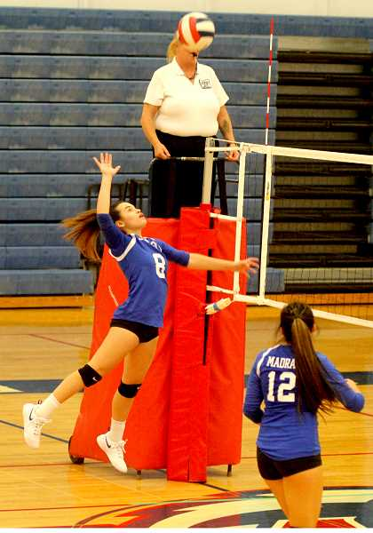 STEELE HAUGEN - Olivia Symons soars high in the Buffs' 3-1 loss to North Marion.