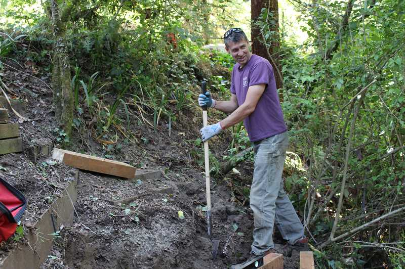 TIDINGS PHOTO: PATRICK MALEE - City arborist Mike Perkins works on installing part of the trail.