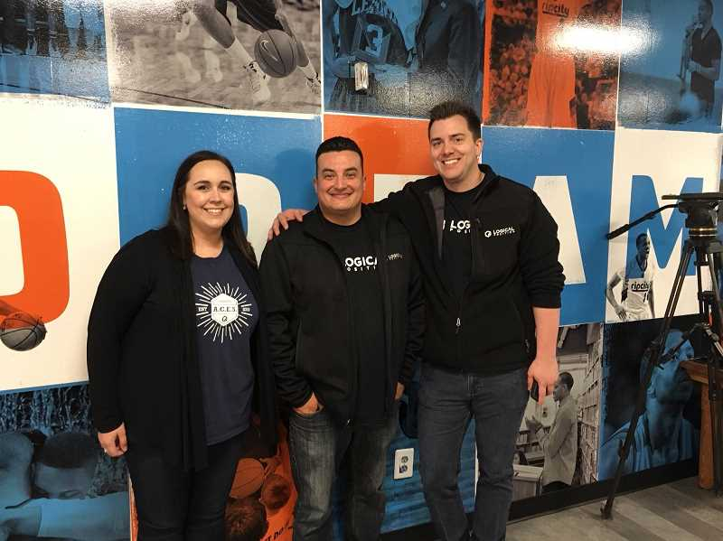 SUBMITTED PHOTO - Ashlee Schneider, Rene Brito and Peter Erickson-Knight from Lake Oswego-based Logical Position dropped off 100 pounds of school supplies the agency collected over the summer to the Blazers Boys & Girls Club.
