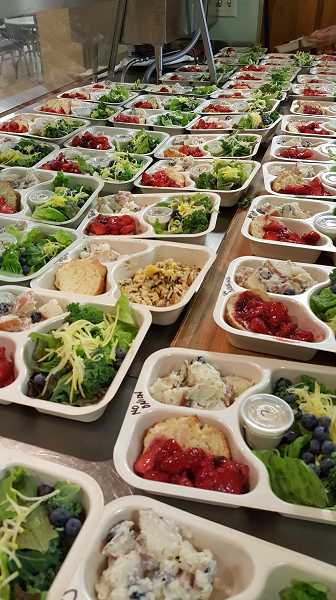 SUBMITTED PHOTO: MARIA BIGELOW - Nearly 20,000 meals are prepared at the Lake Oswego Adult Community Center each year for delivery by Meals on Wheels volunteers. This month, a series of fundraisers will help to support that effort.