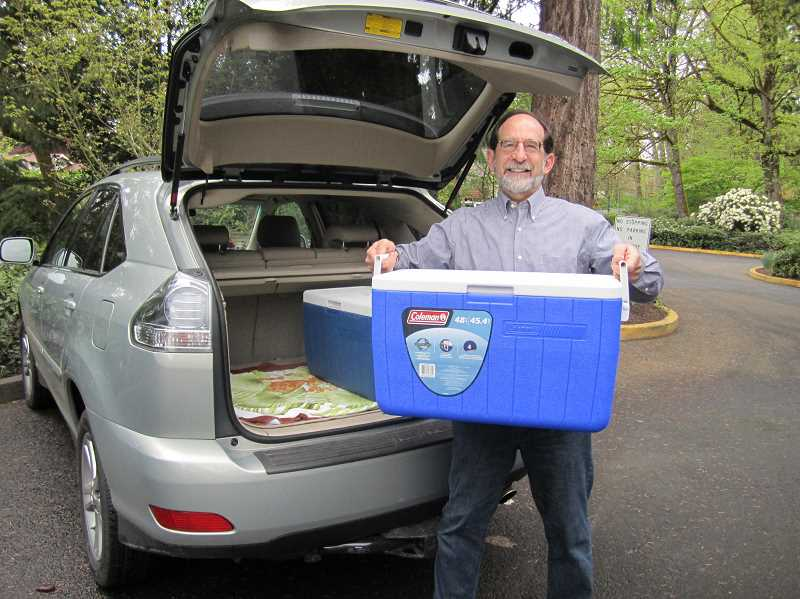 SUBMITTED PHOTO: MARIA BIGELOW - Meals on Wheels volunteer Andy Harris loads his car before delivering emals to clients across Lake Oswego.